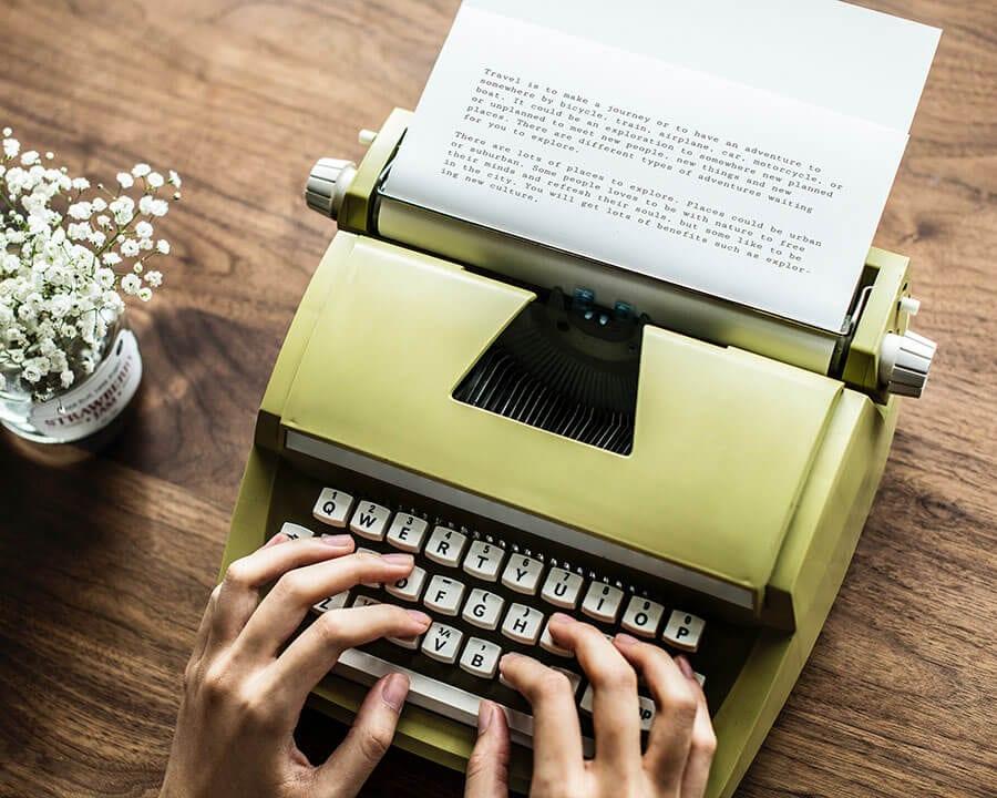 woman typing on typewriter
